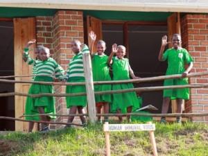 Nyaka AIDS Orphanage - girls in green dresses